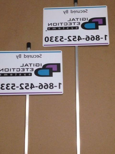 2 reflective dds security yard signs mounted